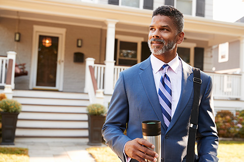 Man in suit with coffee in hand ready to start his day