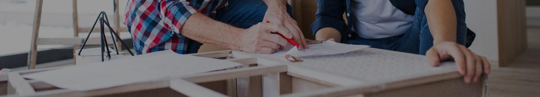 Two men building a kitchen cabinet