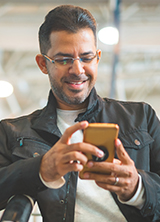 Man smiling using a cell phone